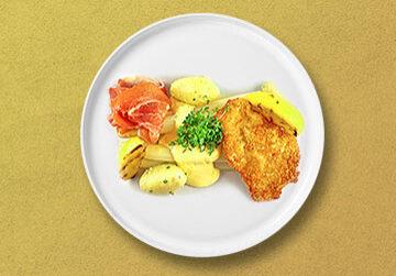 Frischer Spargel mit Kalbsschnitzel, Parmaschinken, neuen Kartoffeln, zerlassener Butter und hausgemachter Sauce Hollandaise